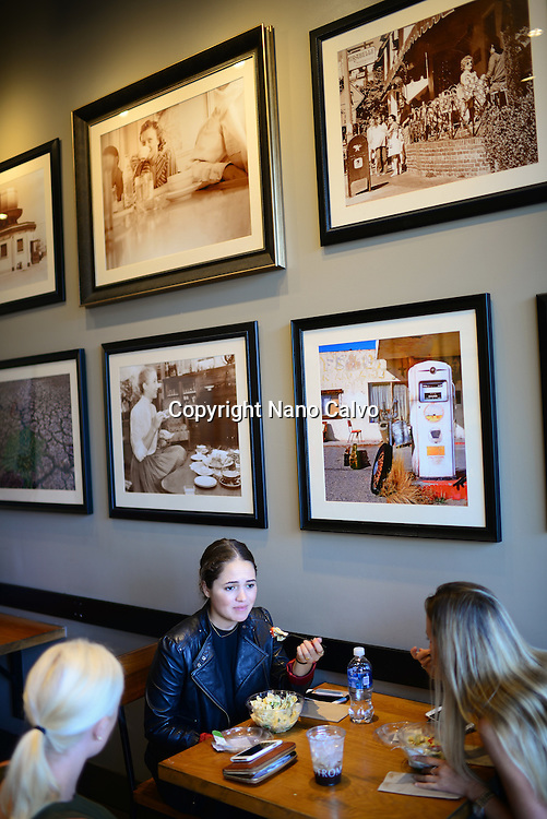 Young girls inside a cafe at The Grove, Los Angeles, California.