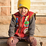 Portrait of boy sitting on step in village of Chandelao, Rajasthan