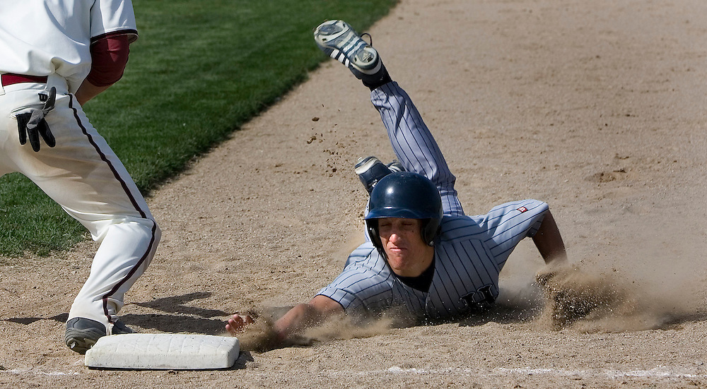 Hunter's Chad Ninow dives back safely to first base during game with Northridge  at Northridge High School in Layton, Utah, Friday, April 6, 2007 in Salt Lake City, Utah. August Miller/ Deseret Morning News