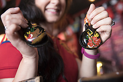 July 1, 2018 - Miami Beach, FL, USA - Gisselle Riestra-Vidal, 37, shows off her castanets at Tapas and Tintos, a restaurant in Miami Beach, Fla. where fans gathered to watch Spain take on Russia during the 2018 FIFA World Cup Round of 16 knockout stage on Sunday, July 1, 2018. After the score being tied 1-1 at the end of extra time, Russia won, 4 penalty kicks to 3. (Credit Image: © Ellis Rua/TNS via ZUMA Wire)