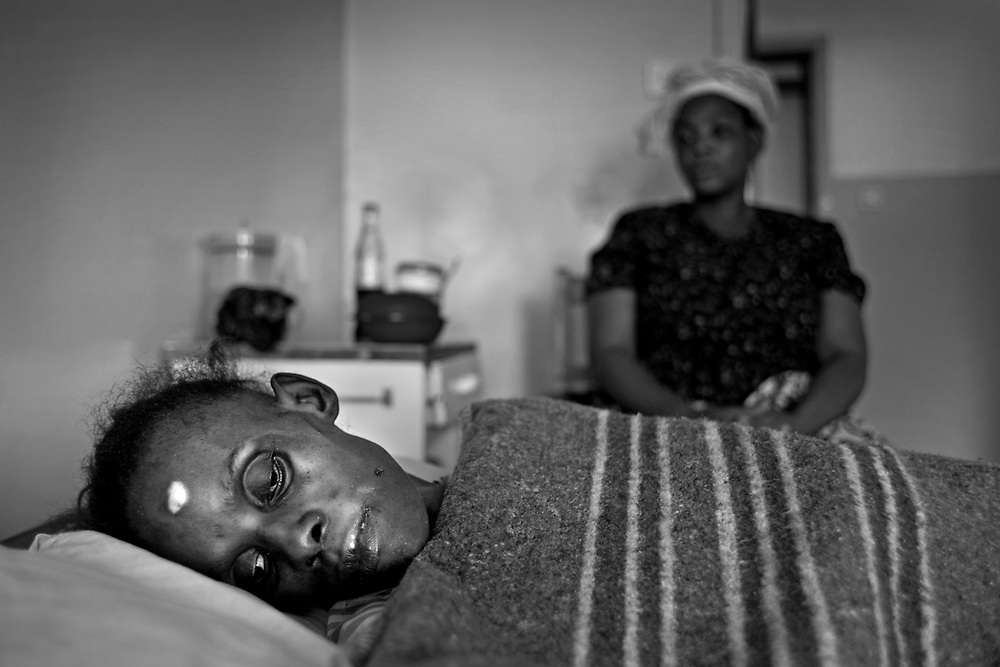 Living positively, HIV/AIDS in Zambia...34 year old Kanise Msitini suffers from TB due to AIDS. She's being treated at a Jons hospice for terminally ill HIV/AIDS patients in Lusaka. Her sister and her cousin visits her every day taking care of her needs...Photo: Markus Marcetic/MOMENT