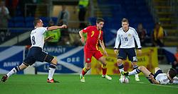 CARDIFF, WALES - Friday, October 12, 2012: Wales' Joe Allen in action against Scotland during the Brazil 2014 FIFA World Cup Qualifying Group A match at the Cardiff City Stadium. (Pic by David Rawcliffe/Propaganda)