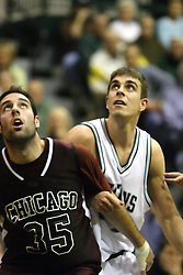 16 December 2006: Jason Vismantas blocks out Zach Freeman. The University of Chicago Maroons upset  the Illinois Wesleyan Titans 64 - 60 at the Shirk Center in Bloomington Illinois.<br />