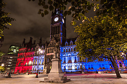 © Licensed to London News Pictures . 15/07/2016 . Manchester , UK . Manchester Town Hall illuminated in the colours of the French Tricolore flag , in a show of solidarity with the people of France following the Bastille Day terror attack in Nice . Photo credit : Joel Goodman/LNP