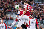 July 15 2017: Arsenal player Olivier Giroud (12) goes up for the ball at the International soccer match between English Premier League giants Arsenal and A-League team Western Sydney Wanderers at ANZ Stadium in Sydney.