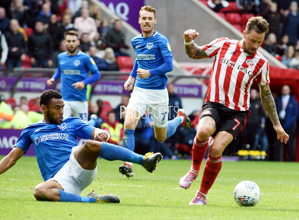 Chrsi Maguire gets around Jamal Lowe during the EFL Sky Bet League 1 match between Sunderland and Portsmouth at the Stadium Of Light, Sunderland, England on 27 April 2019.