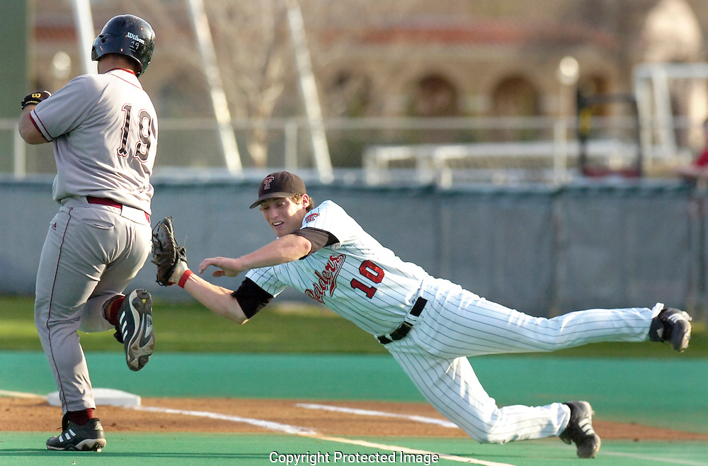 Jodi Miller Lubbock Avalanche-Journal.Texas Tech first baseman James Leverton, 10, dives to tag out New Mexico State's Leo Aguirre, 19, during Tuesday night's game at Dan Law Field.