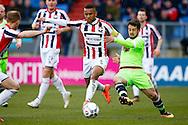 06-03-2016 VOETBAL:WILLEM II-AJAX:TILBURG<br /> Amin Younes van Ajax in duel met Funso Ojo van Willem II <br /> <br /> Foto: Geert van Erven
