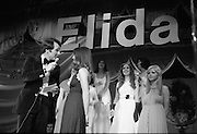 """Miss Elida"" Final At Mosney, Co Meath..1976..01.09.1976..09.01.1976..1st September 1976..The final of the ""Miss Elida"" lovely hair competition was held in The Gaiety Theatre,Butlins Holiday Centre,Mosney,Co Meath tonight. The competition is sponsored by Lever Bros,Sheriff St,Dublin. The shows compere was Mr Mike Murphy..Image shows Mike Murphy interviewing one of the contestants on stage at the Gaiety Theatre."