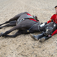 """Windsor (Berks.) April 29th Liut. Corp Stephen Heeley with his horse Yeoman performs the difficult  """"resting routine"""" during the  photocall ahead  of the annual Windsor Cstle Royal Tattoo that will take place  13th-16th May 2009...Standard Licence feee's apply  to all image usage.Marco Secchi - Xianpix tel +44 (0) 845 050 6211 .e-mail ms@msecchi.com .http://www.marcosecchi.com"""