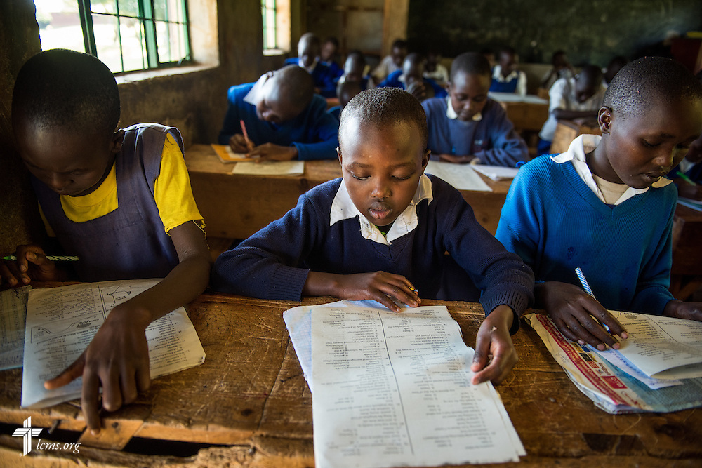 Several pictured students from the U-Dom ELCK (Evangelical Lutheran Church in Kenya) Project 24 site prepare for exams on Thursday, June 23, 2016, at the Propoi Primary School in Chepareria, Kenya.  LCMS Communications/Erik M. Lunsford