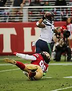 Nov 26, 2017; Santa Clara, CA, USA; San Francisco 49ers defensive tackle Sheldon Day (96) pressures quarterback Russell Wilson (3) against the Seattle Seahawks at Levi's Stadium. Seattle beat San Francisco 24-13.