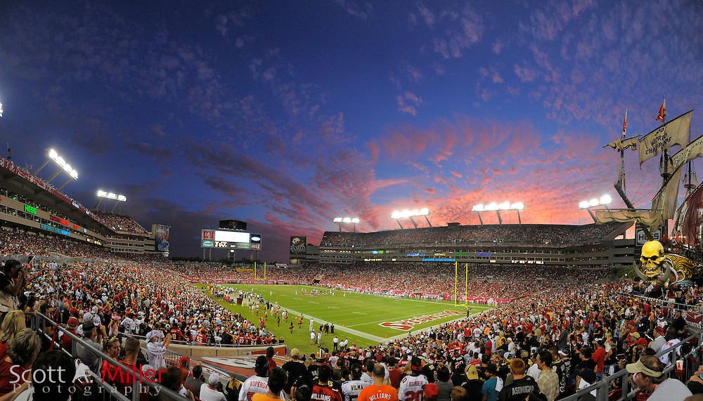Panoramic view of the sun setting behind Raymond James Stadium during the Tampa Bay Buccaneers 26-20 win over the New Orleans Saints on Oct. 16, 2011 in Tampa, Fla...©2011 Scott A. Miller