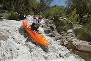 Man kayaking on mountain river