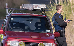 A Suzuki vehicle with a bullet hole in the windscreen as armed police man a road block on Mt Tiger Road after two women were found dead and a man was taken to hospital with gunshot wounds, with the house at the centre of attention now having been engulfed in fire, Whangarei, New Zealand, Wednesday, July 26, 2017. Credit:SMPA / Malcolm Pullman   **NO ARCHIVING**
