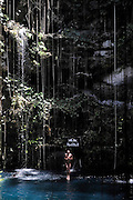 Sinkhole cliff diving competition held in Mexico<br /> <br /> Daredevil athletes have jumped from the edge of a 90ft deep sinkhole in a remote part of Mexico, as part of a cliff diving contest.<br /> Divers in the 'Cliff Diving World Series' performed stunts and reached speeds of 40mph before hitting the dark water of Cenote Ik Kil.<br /> Gary Hunt, from Southampton was the overall winner and managed to pull off a Triple Quad – one of the most difficult dives in the world.<br /> The Red Bull event lasted for two days -- though most of that time was probably taken up trying to get back out after each jump. <br /> Gary scored 373.85 and edged out second-placed Silchenko by a little over 10 points, with 2009 champion Duque taking third place.<br /> <br /> Photo Shows: Cyril Oumedjkane of France dives from the 27.2 metre platform during round two of the 2010 Red Bull Cliff Diving World Series, Cenote Ik Kil, Yucatan, Mexico on June 05; 2010.<br /> (©Ray Demski/Exclusivepix)