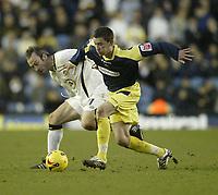 Photo: Aidan Ellis.<br /> Leeds United v Derby County. Coca Cola Championship. 09/12/2006.<br /> derby's David Jones (R) battles with Leeds Shaun Derry