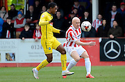 Matt Richards plays the ball during the Sky Bet League 2 match between Cheltenham Town and Plymouth Argyle at Whaddon Road, Cheltenham, England on 28 March 2015. Photo by Alan Franklin.