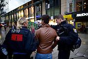 Frankfurt am Main | 08 Oct 2014<br /> <br /> Am Mittwoch (08.10.2014) nahmen an der Konstablerwache in der Innenstadt von Frankfurt am Main etwa 100 Menschen an einer Kundgebung f&uuml;r Solidarit&auml;t mit der von IS (ISIS, ISIL, Islamischer Staat) angegriffenen Stadt Kobane (auch: Ain al-Arab) teil. Die kundgebung verlief friedlich, es kam nur zu einer kleinen St&ouml;rung durch einen jungen Moslem, der sich durch einen Redebeitrag in seinem Glauben beleidigt f&uuml;hlte.<br /> Hier: Der St&ouml;rer wird von Polizisten von der Demo verwiesen.<br /> <br /> &copy;peter-juelich.com<br /> <br /> [No Model Release | No Property Release]