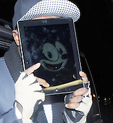 16.APRIL.2012. LONDON<br /> <br /> WILL.I.AM ARRIVING AT THE ROSE CLUB IN LONDON. HE WAS IN HIS VAN FOR 20 MINS BEFORE COMING OUT WITH HIS IPAD COVERING HIS FACE WITH A SONIC THE HEDGEHOG FACE ON IT.<br /> <br /> BYLINE: EDBIMAGEARCHIVE.COM<br /> <br /> *THIS IMAGE IS STRICTLY FOR UK NEWSPAPERS AND MAGAZINES ONLY*<br /> *FOR WORLD WIDE SALES AND WEB USE PLEASE CONTACT EDBIMAGEARCHIVE - 0208 954 5968*