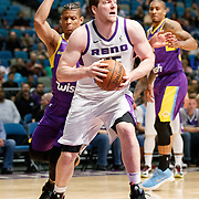Reno Bighorns Center JACK COOLEY (45) drives away from South Bay Lakers Guard SCOTT MACHADO (8) during the Western Conference Semi-Final NBA G-League Basketball game between the Reno Bighorns and the South Bay Lakers at the Reno Events Center in Reno, Nevada.