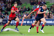 MELBOURNE, AUSTRALIA - APRIL 06: Reece Hodge of the Rebels runs the ball downfield at round 8 of The Super Rugby match between Melbourne Rebels and Sunwolves on April 06, 2019 at AAMI Park in VIC, Australia. (Photo by Speed Media/Icon Sportswire)