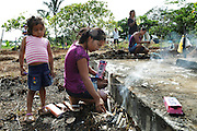 "A family celebrate the All Souls' day in a cemetery in Benjamin Constant .Brasil..The people who live there call the tri-border area between Colombia, Brazil and Perù ""La Frontera"".  This area, in the past rich field for seringueiros (rubber gatherer) and most recently narcos' territory, don't keep trace of the wealth generated here but spent elsewhere. Amazon frontiers areas are notorious for their sparse population and limited state presence."