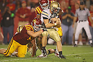 September 26, 2009: Army quarterback Chip Bowden (10) is brought down by Iowa State defensive tackle Nate Frere (62) and Iowa State defensive tackle Stephen Ruempolhamer (97) during the second half of the Iowa State Cyclones' 31-10 win over the Army Black Knights at Jack Trice Stadium in Ames, Iowa on September 26, 2009.