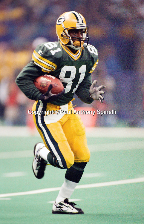 Green Bay Packers wide receiver and kick returner Desmond Howard (81) returns a kick during the NFL Super Bowl XXXI football game against the New England Patriots on Jan. 26, 1997 in New Orleans. The Packers won the game 35-21. (©Paul Anthony Spinelli)