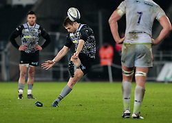 Ospreys' Dan Biggar kicks a penalty<br /> <br /> Photographer Simon King/Replay Images<br /> <br /> European Rugby Champions Cup Round 5 - Ospreys v Saracens - Saturday 13th January 2018 - Liberty Stadium - Swansea<br /> <br /> World Copyright © Replay Images . All rights reserved. info@replayimages.co.uk - http://replayimages.co.uk