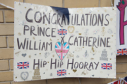 © London News Pictures. 03/04/15. London, UK. A congratulations sign is hung opposite the Lido Wing, St Mary's Hospital, Central London in anticipation of the birth of the second child of the Duke and Duchess of Cambridge. Photo credit: Laura Lean/LNP
