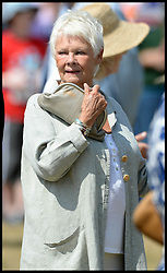 Image ©Licensed to i-Images Picture Agency. 30/07/2014. Norfolk, United Kingdom. Dame Judy Dench joins the Prince Charles and The Duchess of Cornwall visit the Sandringham Flower show on the Queen's Sandringham estate, Norfolk. Picture by Andrew Parsons / i-Images