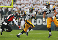 September 01 2012: Iowa Hawkeyes running back Damon Bullock (32) tries to stiff arm Northern Illinois Huskies safety Dechane Durante (21) as Iowa Hawkeyes offensive linesman Brandon Scherff (68) looks on during the first half of the NCAA football game between the Iowa Hawkeyes and the Northern Illinois Huskies at Soldiers Field in Chicago, Illinois on Saturday September 1, 2012. Iowa defeated Northern Illinois 18-17.
