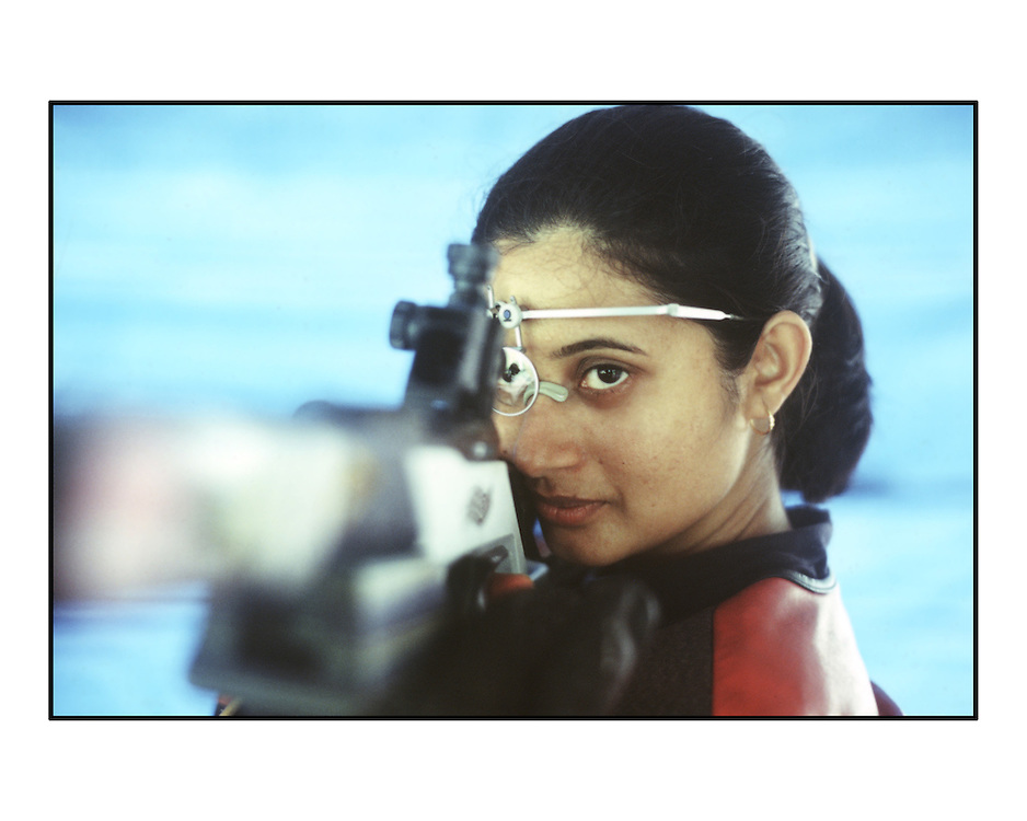 Rifle Shooter Anjali Bhagwat photographed at the Worli Shooting Range, Mumbai, India. Scan from 35mm colour negative. By Siddharth Siva