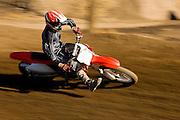 Motocross Racer Taking Corner