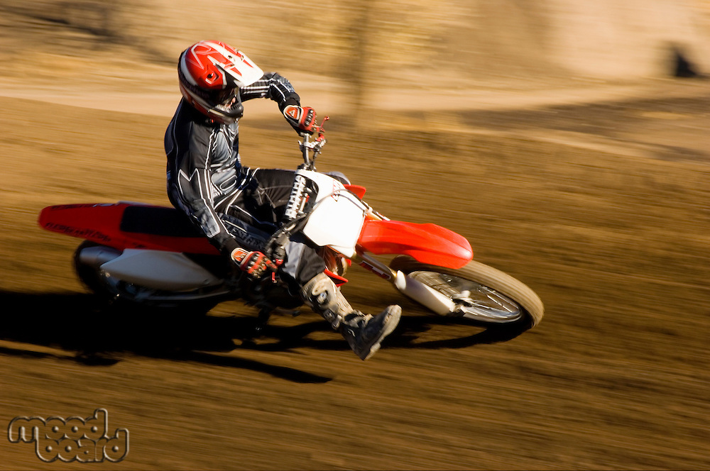 Motocross Racer Taking Corner