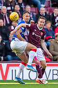 Nikola Katic (#19) of Rangers FC and Steven MacLean (#18) of Heart of Midlothian FC fight for the ball during the Ladbrokes Scottish Premiership match between Heart of Midlothian and Rangers FC at Tynecastle Park, Edinburgh, Scotland on 20 October 2019.