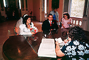 HAVANA, CUBA: A couple at their wedding in a government Palacio de Matrimonios (wedding palace) in Havana, Cuba, March 2000. Cuba is officially a secular state and weddings are civil affairs presided over by a government attorney. They take about 15 minutes and are held in government wedding offices.   PHOTO BY  JACK KURTZ       WOMEN   CULTURE   LIFESTYLE   FAMILY