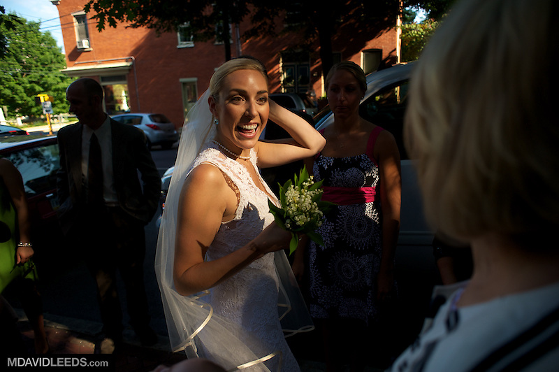Nicole Qualls-Doyle is all smiles as she leaves the church where she and Ian Doyle were married in Lancaster, PA
