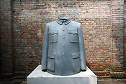 A sculpture depicting Mao's signature jacket, also the uniforn of the working class, in a Dashanzi art gallery. China's art scene is becoming popular among foreign art collectors pushing prices higher.