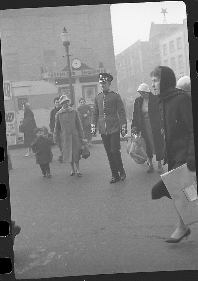Peter Hughes in Guard Uniform.   B269..1960..06.01.1960..01.06.1960..6th January 1960..Pictured strolling through Dublin was Mr Peter Hughes resplendent in his Guards Uniform...Image taken as Peter crosses O'Connell Street near Nelson's Pillar.