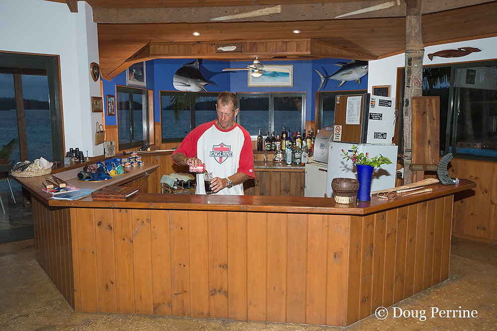 owner Steve Campbell tends bar at Ika Lahi Fishing Lodge, Hunga Island, Vava'u, Kingdom of Tonga, South Pacific