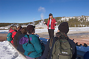 Julianne Baker of Yellowstone Association Institute telling winter visitors about geothermal activity in the Upper Geyser area of Yellowstone National Park.