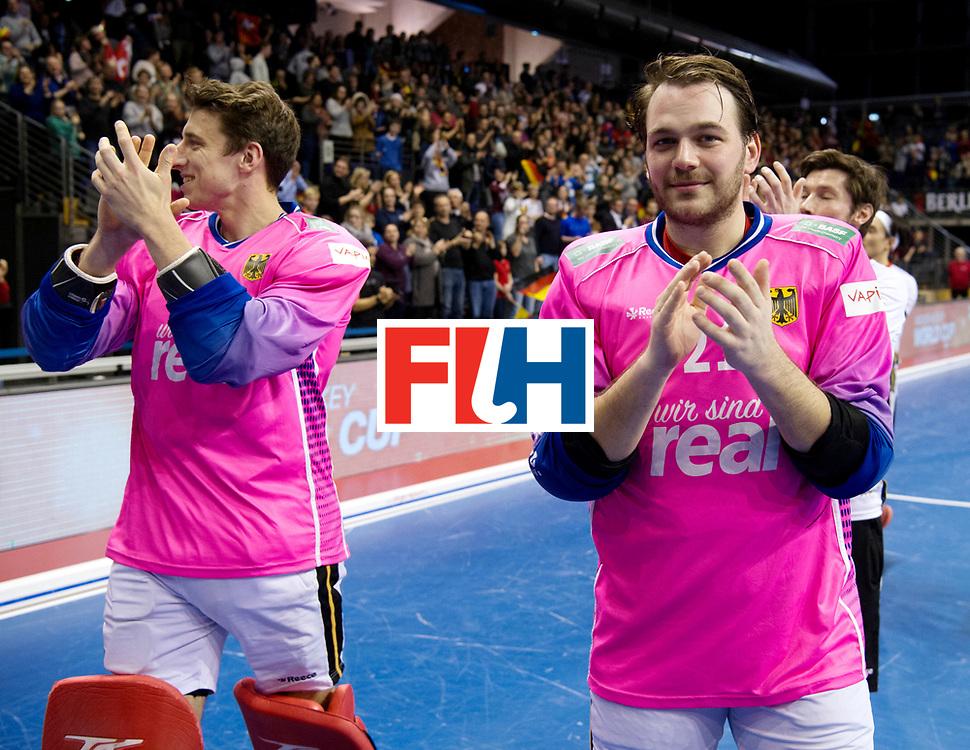 BERLIN - Indoor Hockey World Cup<br /> Quarterfinal 3: Germany - Switzerland<br /> foto: Dan Nguyen and the Mascot.<br /> WORLDSPORTPICS COPYRIGHT FRANK UIJLENBROEK