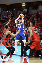 21 February 2018:  Reed Timmer shoots over William Tinsley during a College mens basketball game between the Drake Bulldogs and Illinois State Redbirds in Redbird Arena, Normal IL