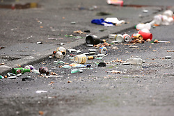 Rubbish on the street following the Caribbean Carnival, where armed police were called to Claremont Road, Moss Side, Manchester, at 2.30am on Sunday after several people were injured in a shooting.