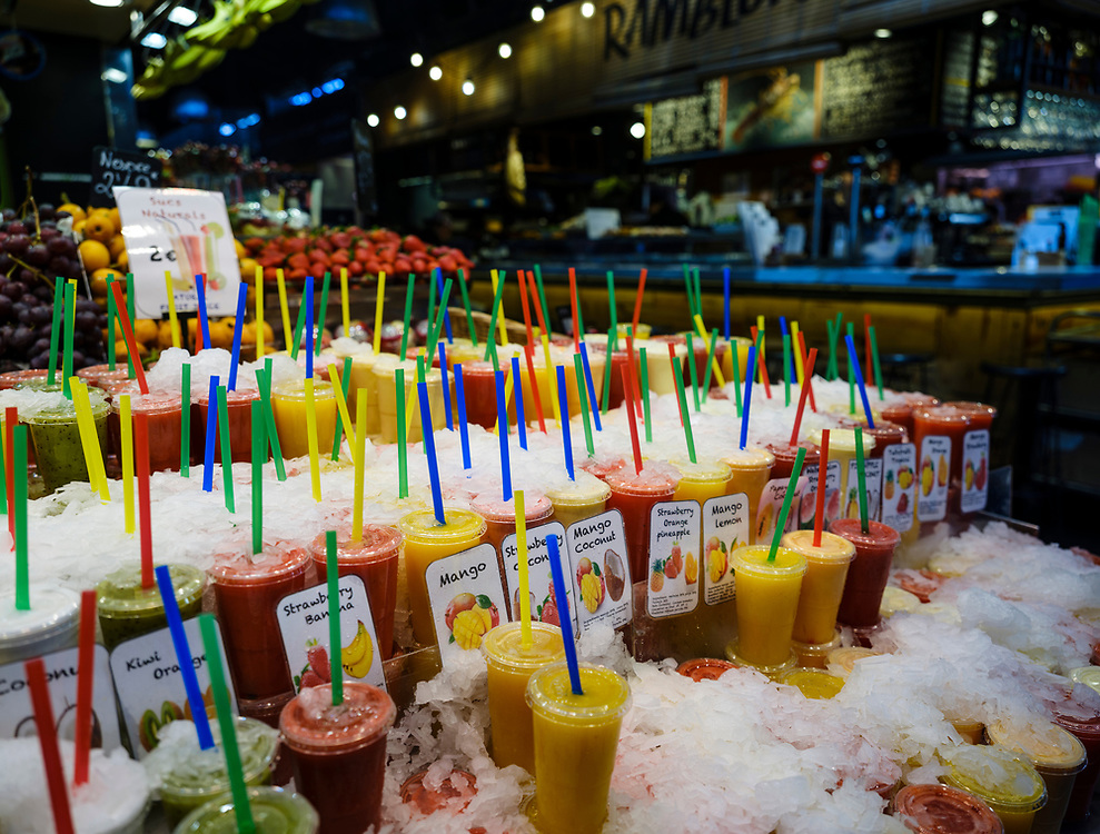 BARCELONA, SPAIN - CIRCA MAY 2018: Juice Stall in La Boqueria. This is a large public market in the Ciudad Vieja district of Barcelona, Catalonia, Spain, and one of the city's foremost tourist landmarks.