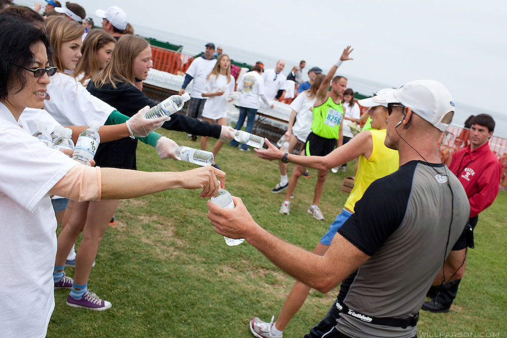 Patt Tsung hands out water with other volunteers.