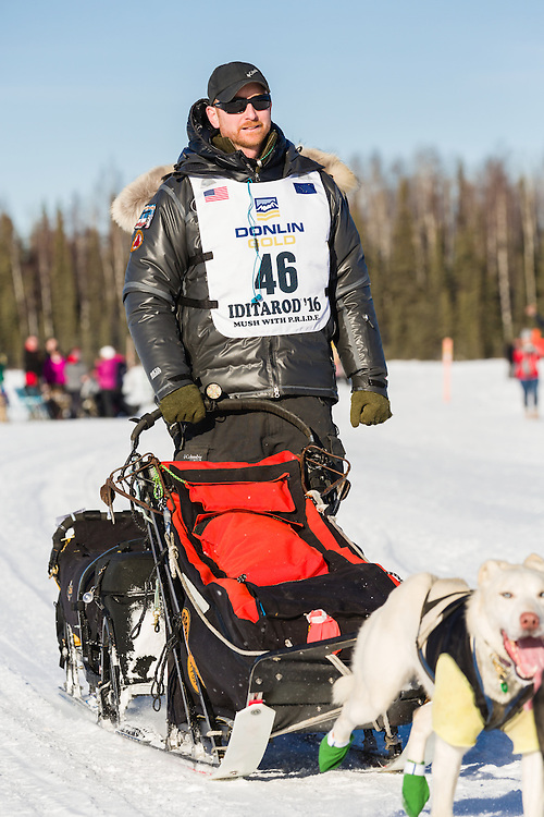 Musher Justin Savidis competing in the 44th Iditarod Trail Sled Dog Race on Long Lake after leaving the restart on Willow Lake in Southcentral Alaska.  Afternoon. Winter.