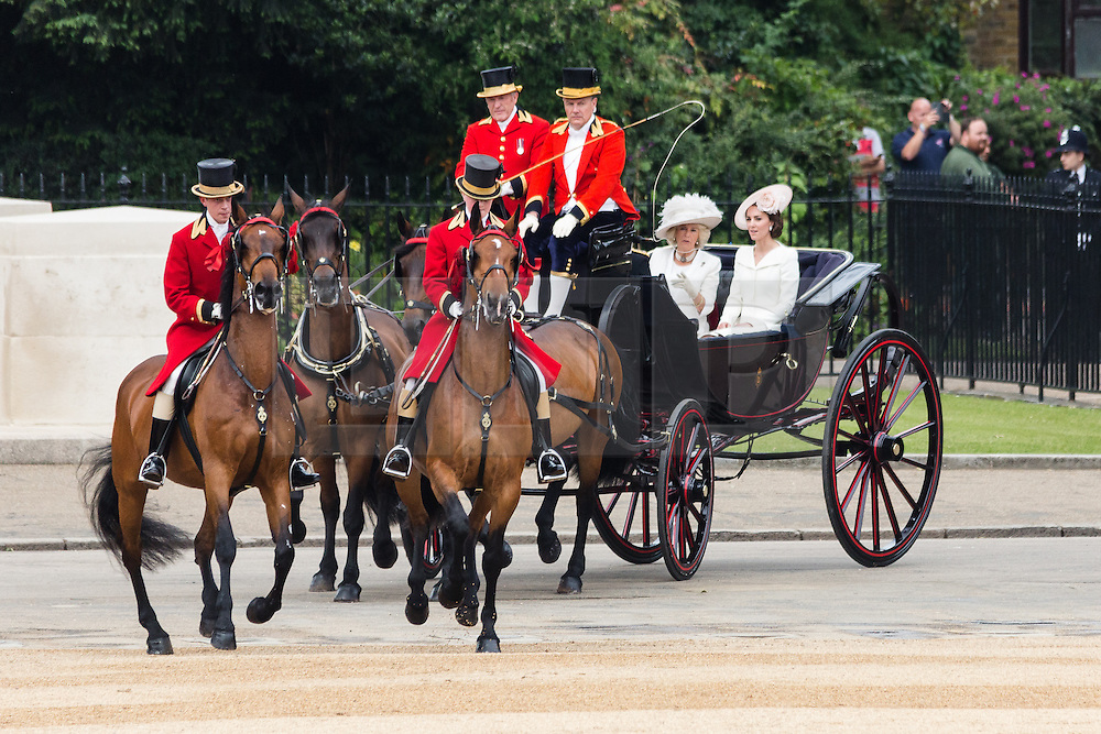 © Licensed to London News Pictures. 11/06/2016. LONDON, UK.  Kate, Duchess of Cambridge and Camilla, Duchess of Cornwall at the Trooping the Colour ceremony in Horse Guards parade. Around 1,500 soldiers take part in the annual Trooping of the Colour ceremony, which this year celebrates the 90th birthday of Her Majesty Queen Elizabeth II.  Photo credit: Vickie Flores/LNP